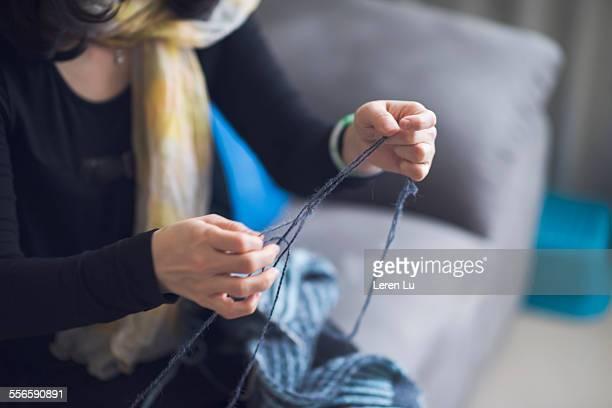 Woman knitting wool