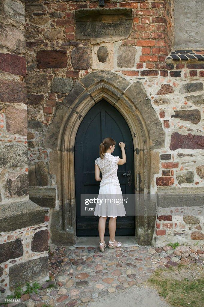 Woman Knocking at Church Door