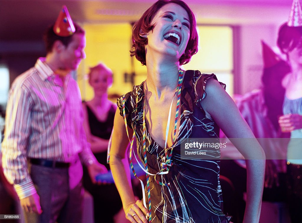 Woman laughing at office party, close-up
