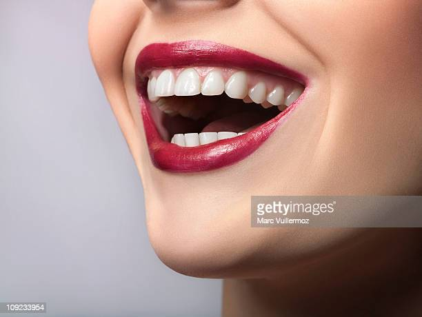 Woman laughing, close-up of mouth