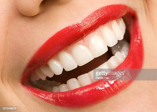 Woman laughing, close-up of mouth, red lips