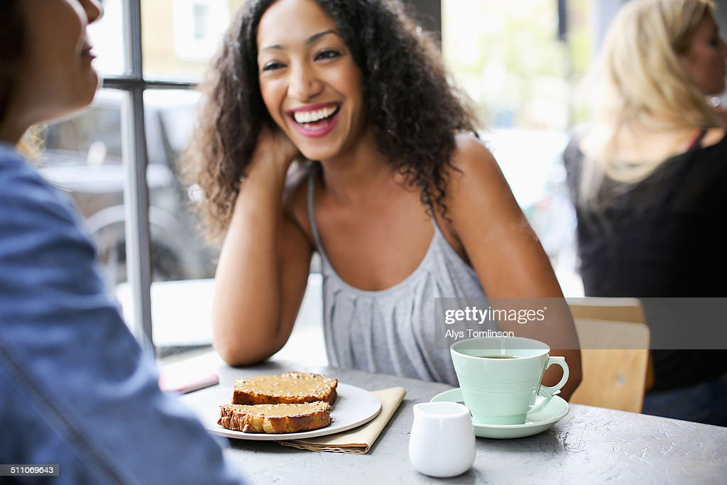 Woman Laughing in a Cafe : Stock Photo