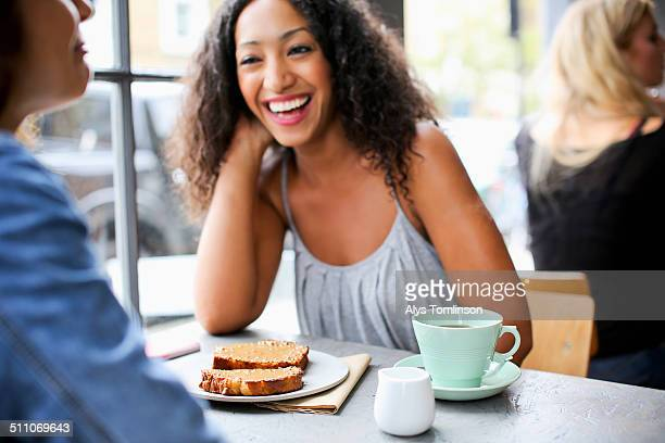Woman Laughing in a Cafe