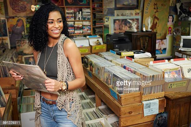 Woman laughing in a used record store