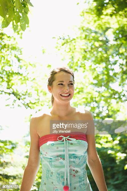 Woman laughing in forest
