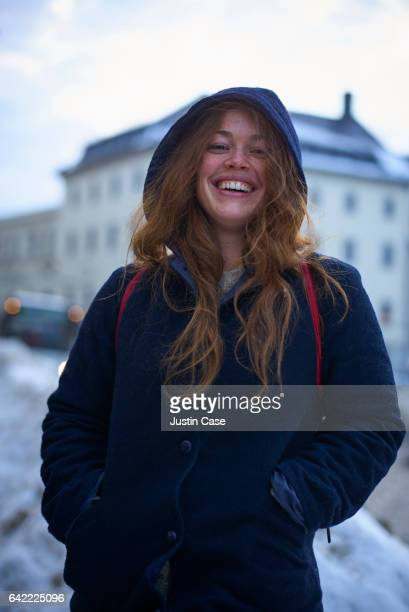 woman laughing in snowy cityscape