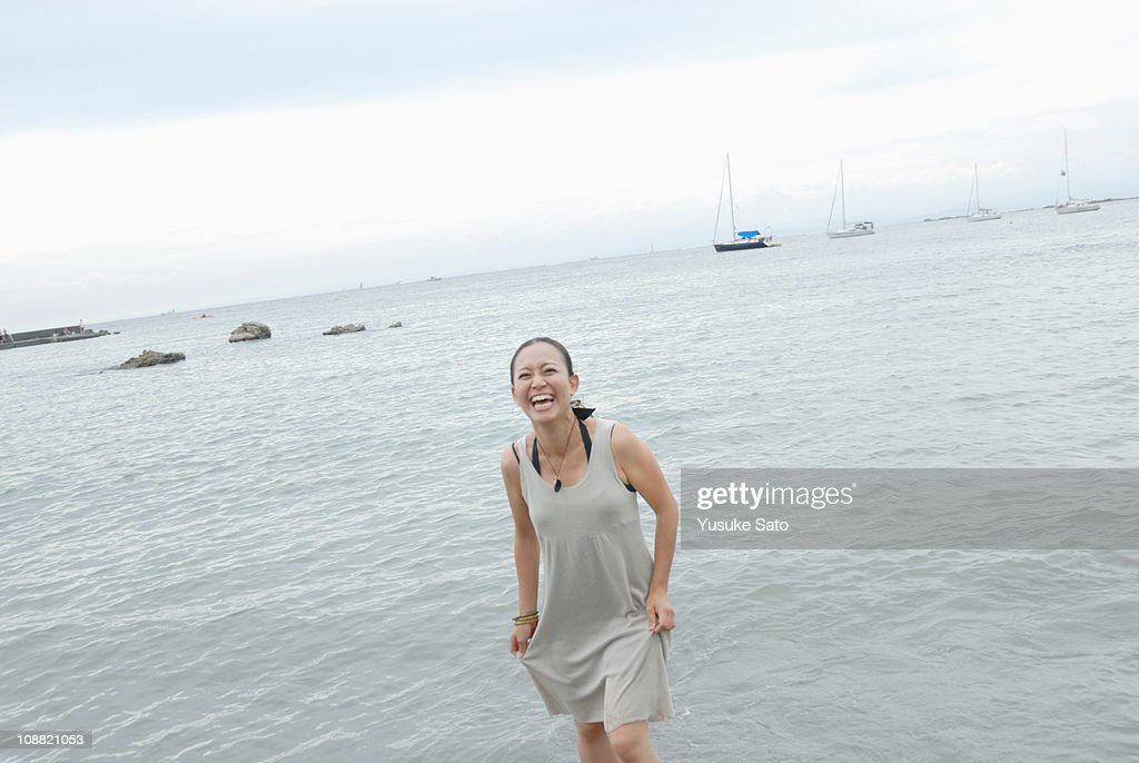 Woman laughing in the seashore