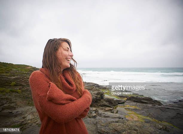 Woman laughing on Atlantic coastline.