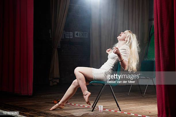woman laughing on theater stage.