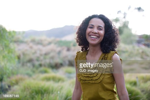 Woman laughing outdoors : Stock Photo