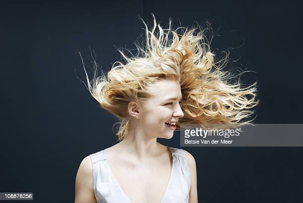 woman laughing with hair tossed in wind.