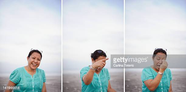 Woman laughing with tears in her eyes