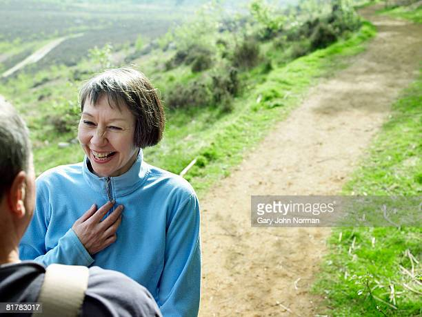 Woman laughs during hiking trip