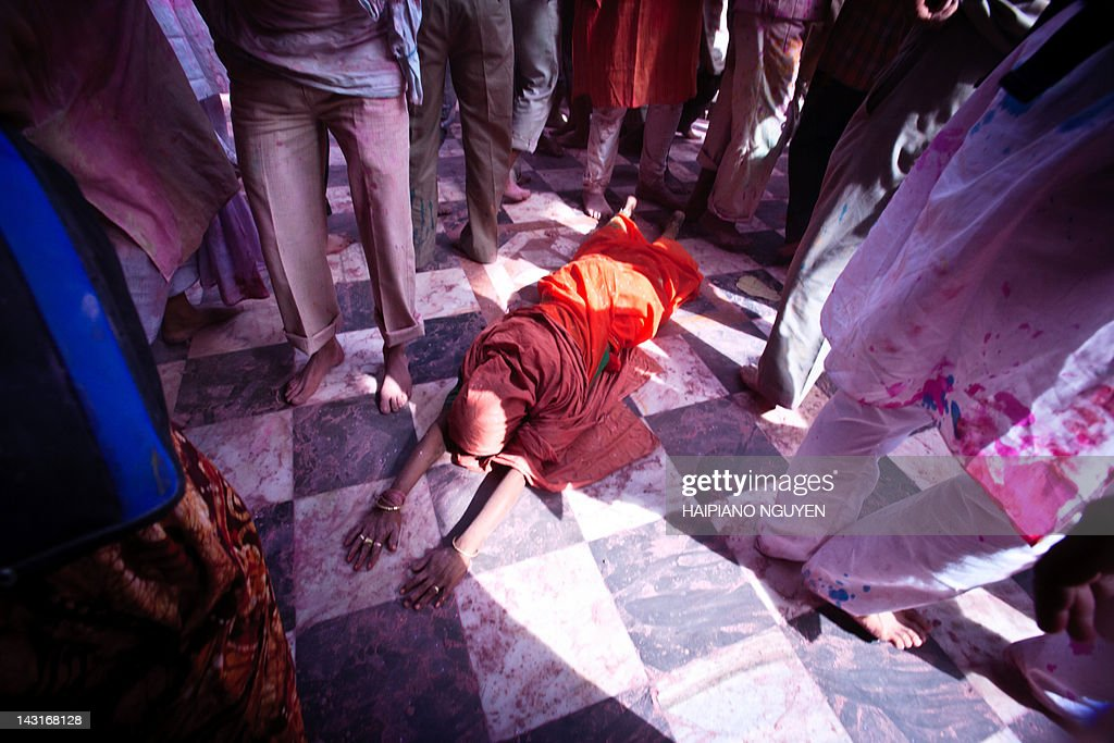 Woman laying down for prays in temple : Stock Photo