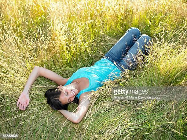 Woman laying down in a field