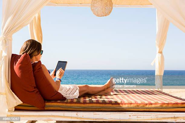 Woman laying in a cabana.