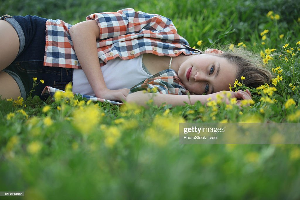 Woman Laying In Field Of Flowers Stock Photo | Getty Images