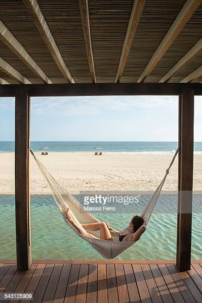 Woman laying on a hamock at a small hotel in the coast of Oaxaca, Mexico.
