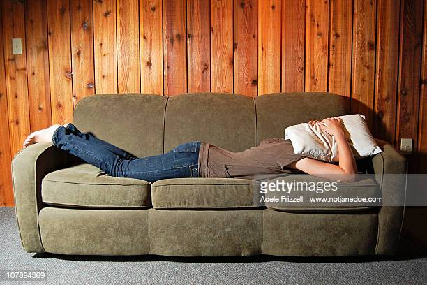 Woman laying on couch