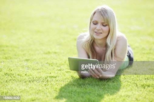 Woman laying on the grass : Stock Photo