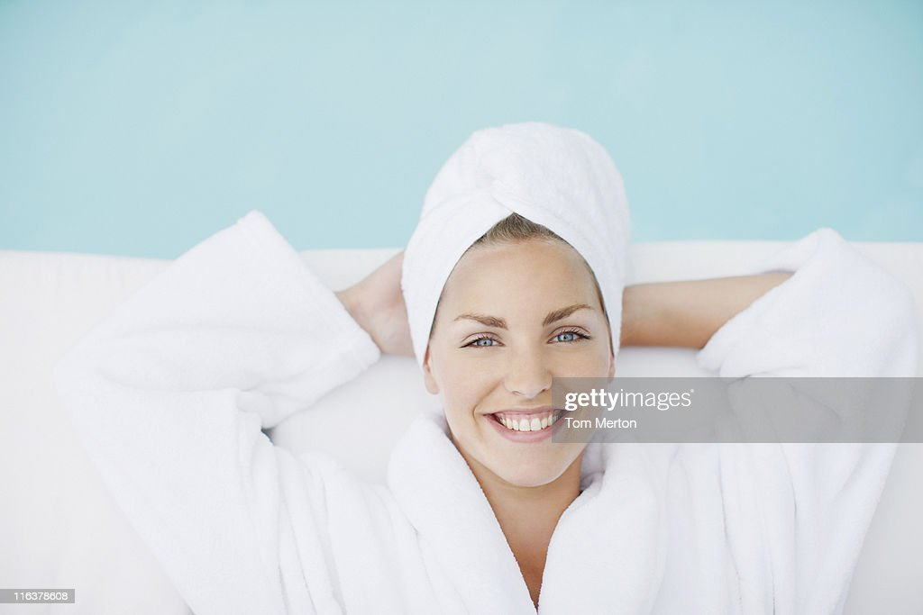 Woman laying poolside : Stock Photo