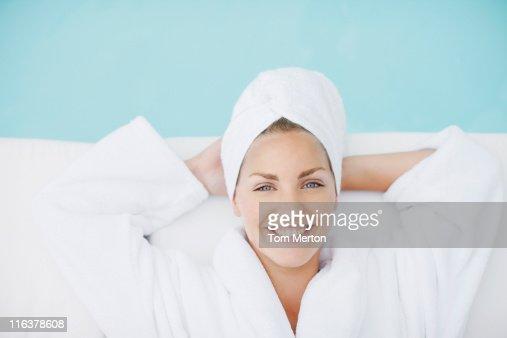 Woman laying poolside : Stock Photo