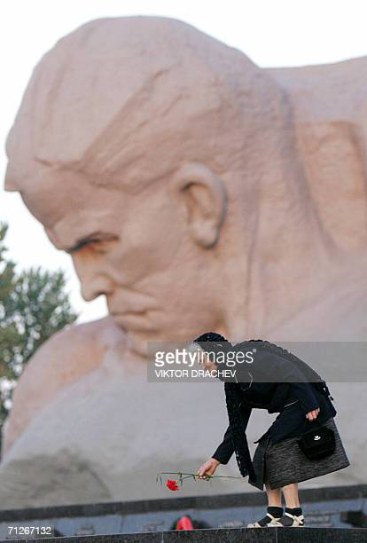 A woman lays a flower at the WW II memorial at Brest fortress on the BelarusPolish border early morning 22 June 2006 Belarus people mark the Day of...