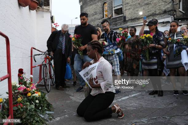 A woman lays flowers outside the Muslim Welfare House near the scene of the attack by Finsbury Park Mosque on June 19 2017 in London England...