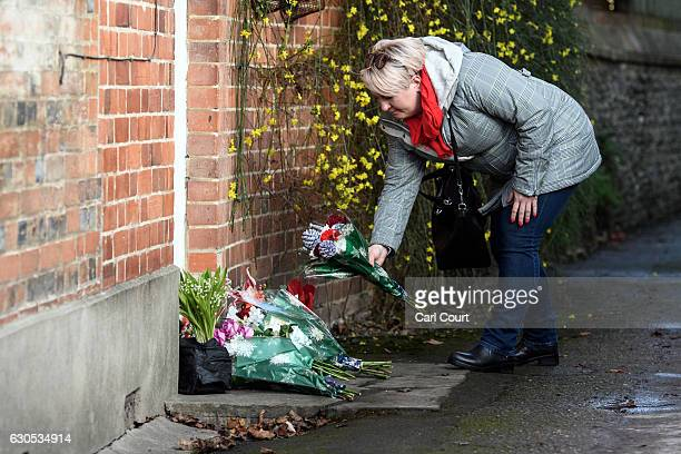 A woman lays flowers outside the Oxfordshire home of British pop singer George Michael on December 26 2016 in Goring England Singer George Michael...