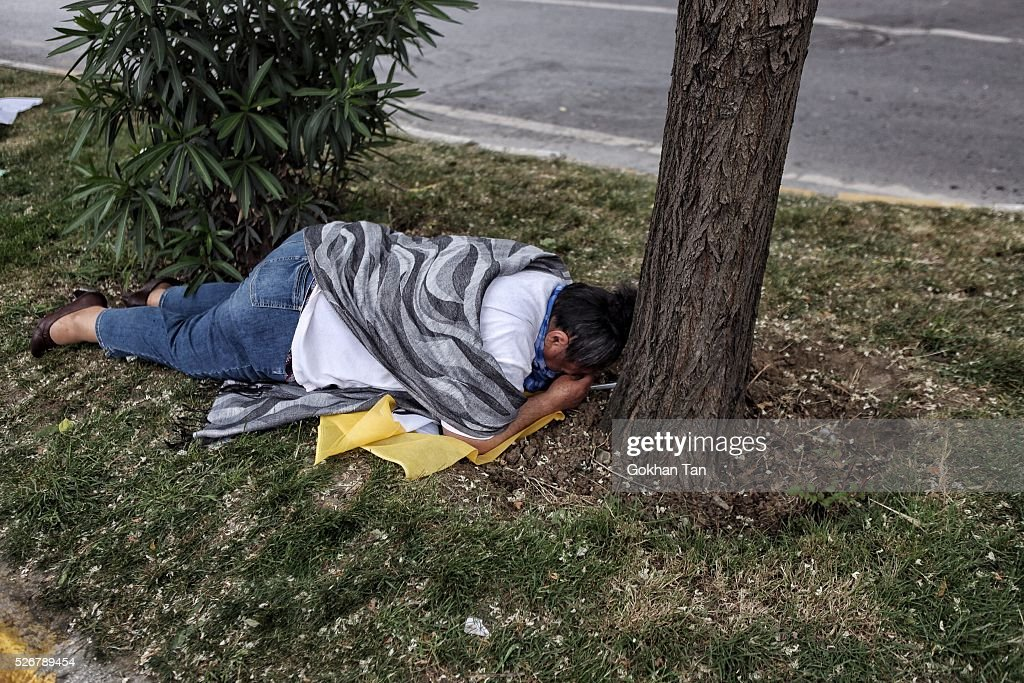 A woman lays on the ground as she is affected by Turkish anti-riot police's tear gas during a May Day rally in Istanbul's Bakirkoy district on May 1, 2016 in Istanbul, Turkey. Turkish police used tear gas and water cannon to disperse protesters as they tried to make their way to Taksim Square and other protest points.