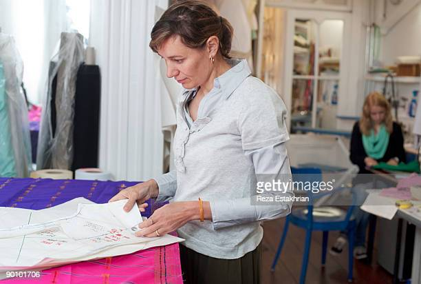 Woman lays out garment pattern pieces