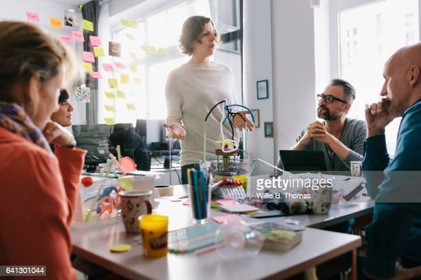 Woman leading business team in discussion
