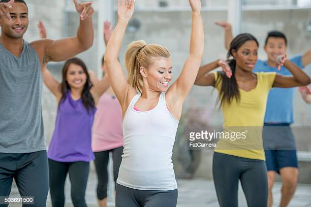 Woman Leading Out a Dance Class
