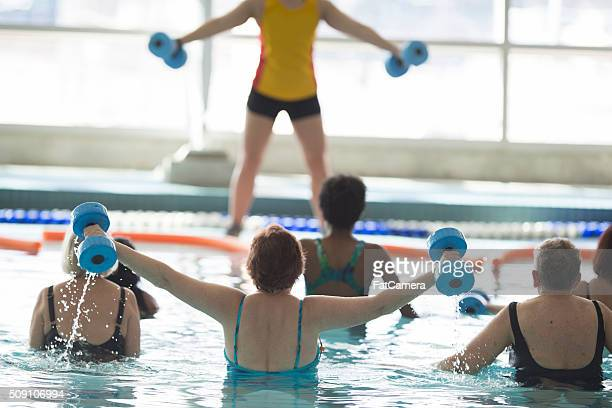Woman Leading Out a Water Fitness Class