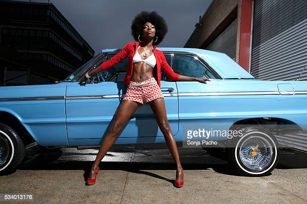 woman leaning against low rider