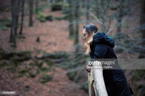 Woman Leaning Against Railing