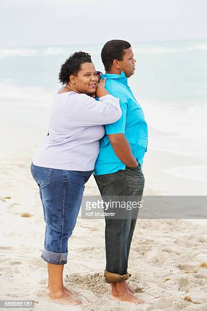 Woman Leaning on Boyfriend on Beach