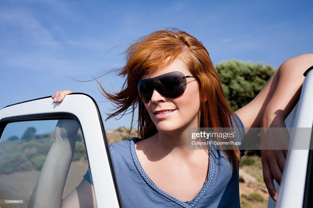 Woman leaning on car : Stock Photo