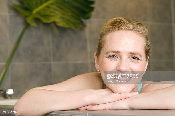 Woman leaning on edge of hot tub