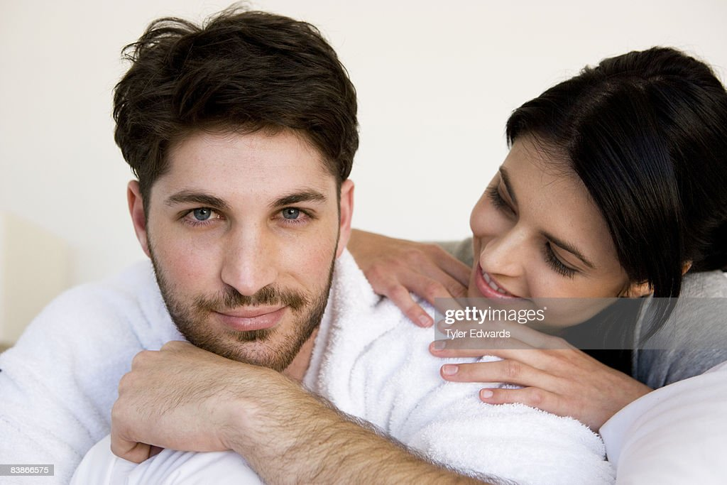 Woman leaning on man's shoulder : Stock Photo
