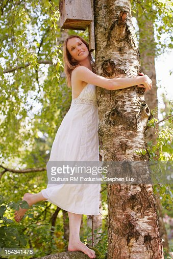 Woman leaning on tree : Stock Photo