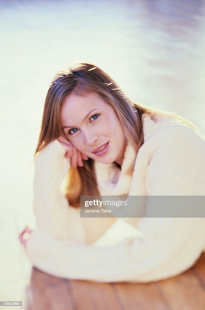 Woman leaning on wooden table, outdoors (selective focus) : Stock Photo
