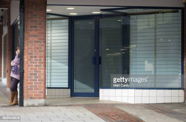 A woman leans against a pillar near a empty shop in the town centre of Yeovil on February 2 2017 in Somerset England Business rates which are based...