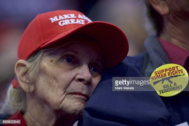 A woman leans on a man's shoulders while listening to Republican Presidential nominee Donald J Trump during a rally at Giant Center November 4 2016...