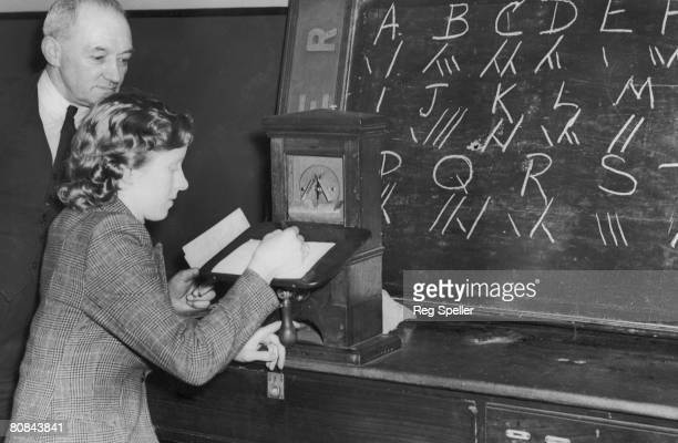 A woman learns how to use an LNER telegraph machine during World War II 3rd January 1942