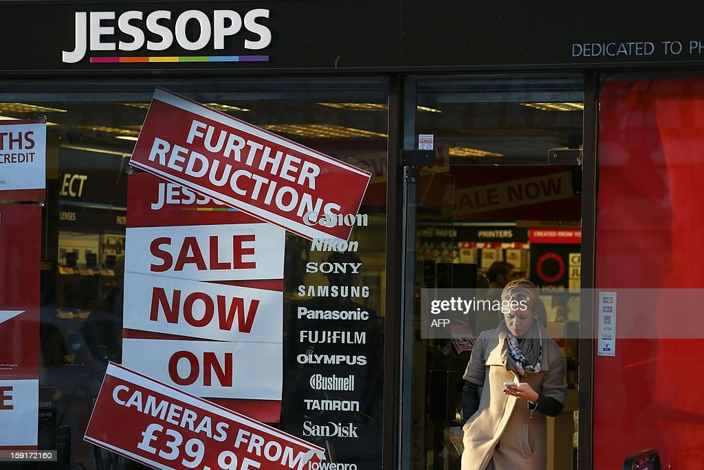 A woman leaves a branch of Jessops camera shop in Central London on January 9, 2013. British photographic chain Jessops went into adminstration on January 9, 2013, putting some 2,000 jobs at risk.