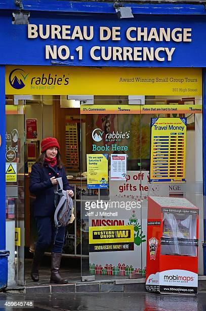 A woman leaves a Bureau De Change on November 27 2014 in Edinburgh Scotland Lord Smith announced that the Scottish Parliament should have the power...