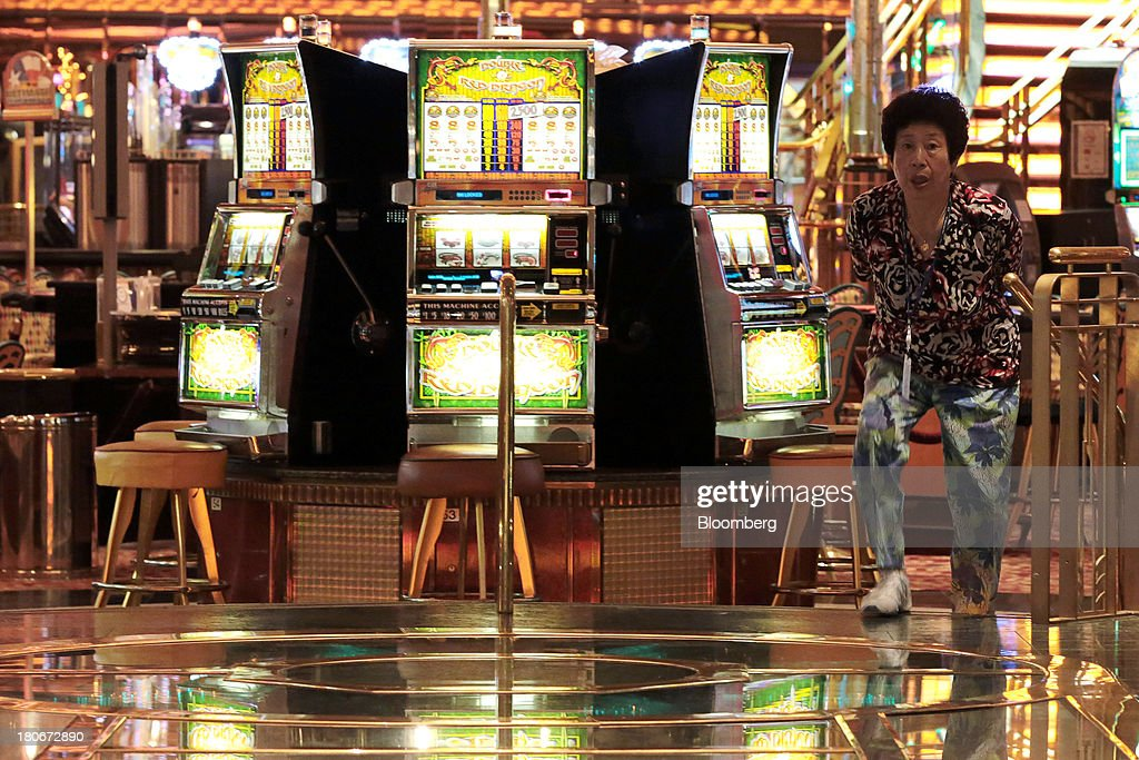 A woman leaves a casino aboard the Royal Caribbean Cruises Ltd.'s Voyager of the Seas, berthed at the Ohi wharf in Tokyo, Japan, on Saturday, Sept. 14, 2013. Royal Caribbean, the worlds second-largest cruise-line operator, doubled its dividend and will make directors stand for election every year. Photographer: Yuriko Nakao/Bloomberg via Getty Images