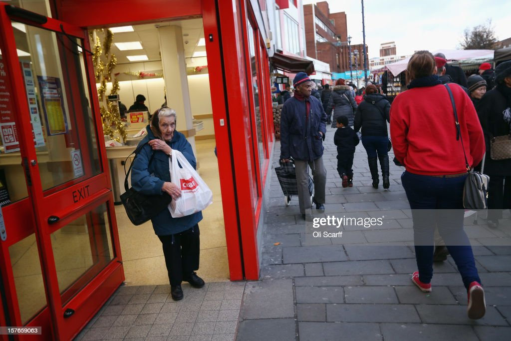 A woman leaves a discount food store on Lewisham high street on December 5, 2012 in London, England. The Chancellor of the Exchequer George Osborne has stated that the United Kingdom's economy is still struggling during his autumn budget statement to Parliament.