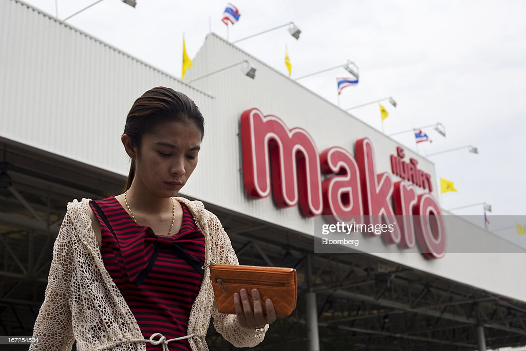 A woman leaves a Makro store, operated by Siam Makro Pcl, in Bangkok, Thailand, on Tuesday, April 23, 2013. Billionaire Dhanin Chearavanont's CP All Pcl, Thailand's 7-Eleven chain, offered to pay about $6.6 billion for discount retailer Siam Makro Pcl in the biggest takeover announced in Asia this year. Photographer: Brent Lewin/Bloomberg via Getty Images